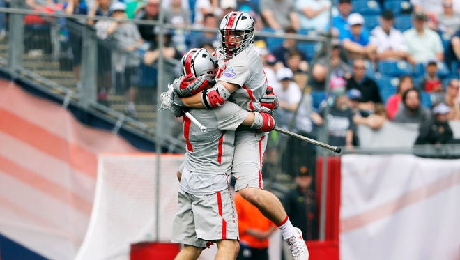 J.T. Blubaugh, right, celebrates his second-half goal with Lukas Buckley.
