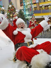 Santa (Byron Fitz) lands at the bottom after sliding