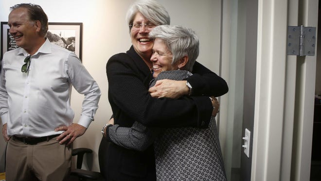 Former University of Iowa senior associate athletic director Jane Meyer, left, gets a hug after giving a press conference on Thursday, May 4, 2017.  A Polk County jury awarded Meyer a victory in her sexual discrimination lawsuit against the University of Iowa to the tune of $1.43 million.