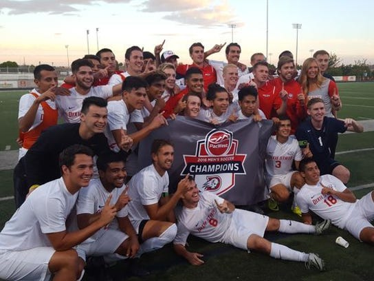 Dixie State men's soccer players celebrate their PacWest
