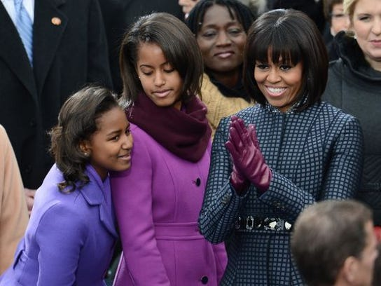First Lady Michelle Obama and her daughters, Sasha