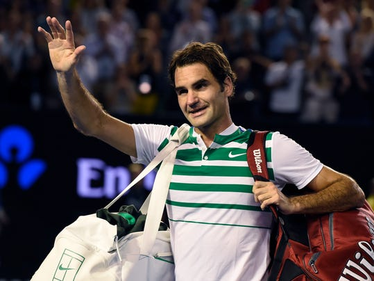 Roger Federer of Switzerland waves as he leaves Rod Laver Arena following his semifinal loss to Novak Djokovic of Serbia at the Australian Open tennis championships in Melbourne, Australia, Thursday, Jan. 28, 2016.(AP Photo/Andrew Brownbill)