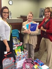 """3. Teachers and students at Bonita Springs Elementary School receive a large donation of school supplies through CNLBank's annual """"Adopt a School Supply Drive."""""""