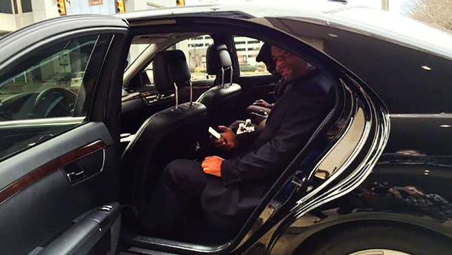 Jackson City Councilman De'Keither Stamps and Mayor Tony Yarber use Uber for the first time.