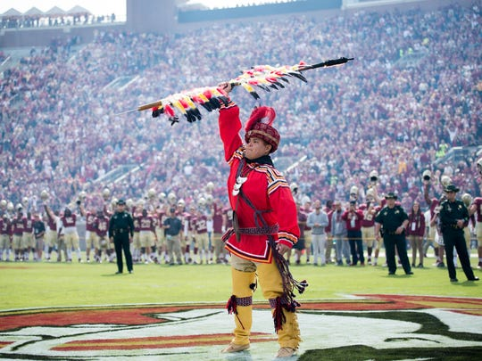 Kyle Doney, Seminole Tribe of Florida member who planted the spear at Doak Campbell Stadium 10 years ago as a student, returns for FSU's game vs. NC State to plant it once more.