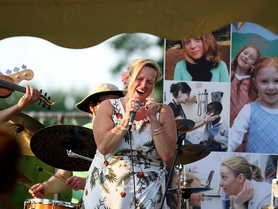 Tammy Fletcher singing at a previous fundraiser at