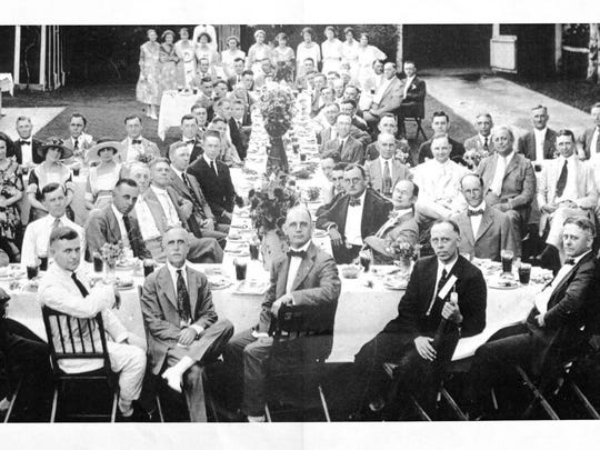 Jackson Rotary Club members and spouses meet for a social event outside a house on King Street in this file photo. The man in the front with his legs crossed, Frank Frankland, was president in 1924-25.