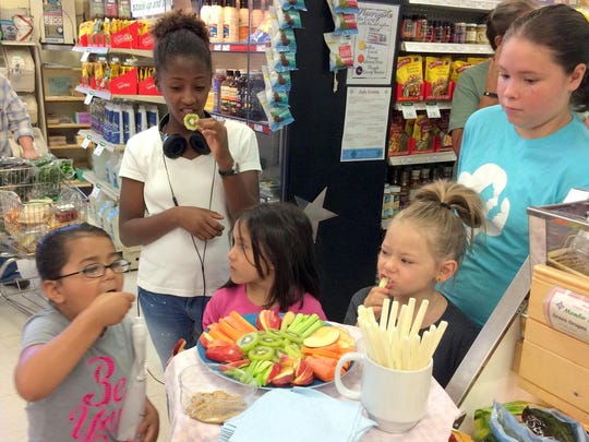From left, are Alexis Gutierrez, Sofia Guevana, Annaleah Mendoza, Hayly Mendoza and Amelia Ellis at the Silver City Food Co-Op learning about nutrition and healthy snacks.