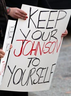 A sign at a #MeTo rally referenced Metro Councilman Dan Johnson.