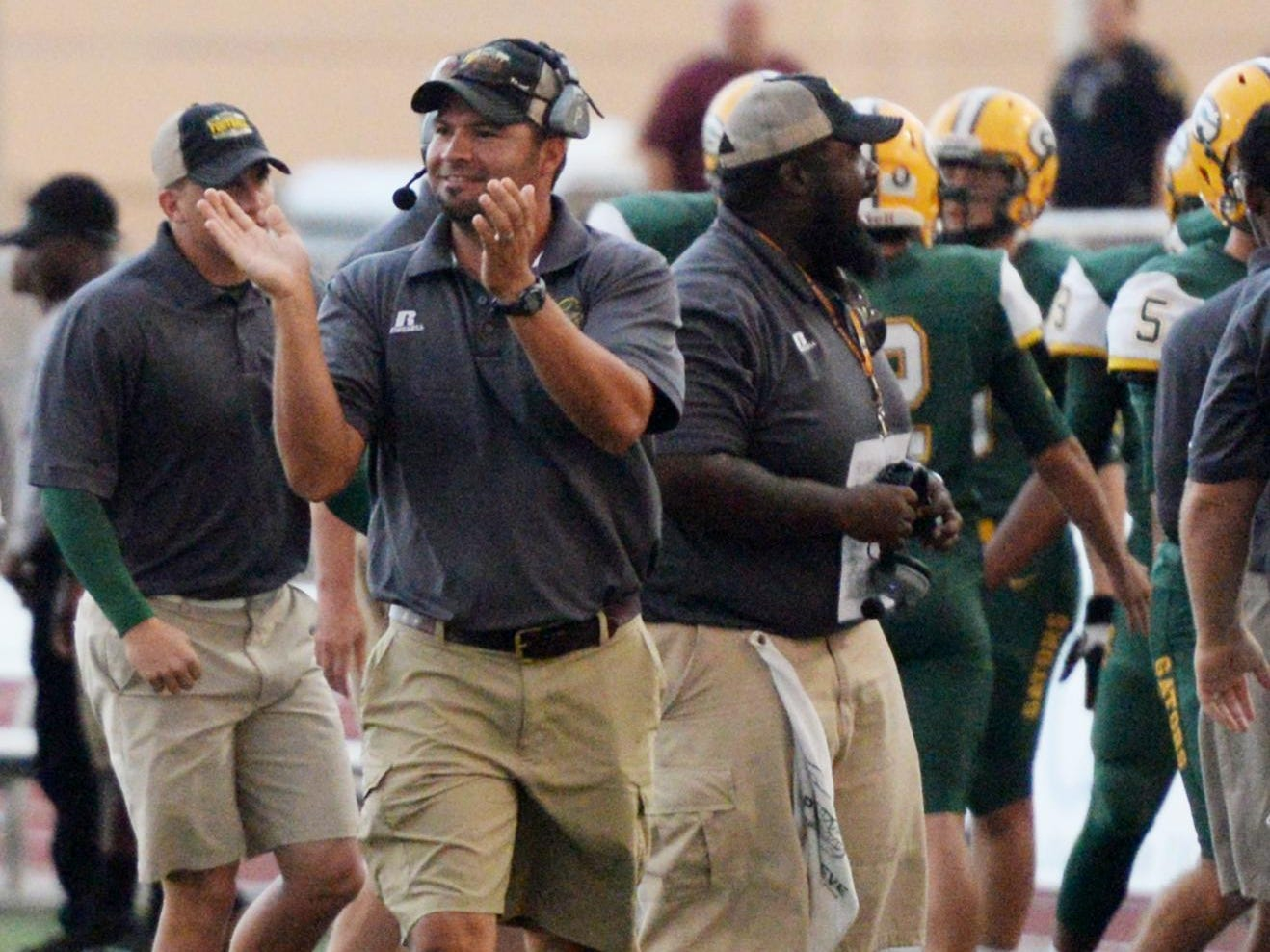 Captain Shreve head coach Bryant Sepulvado (clapping) and the Gators won their second game of the season on Friday.