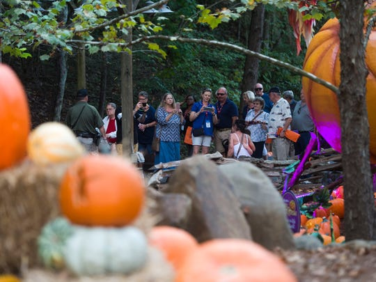 Dollywood attendees check out a pumpkin exhibit at the theme park's nighttime fall experience Great Pumpkin LumiNights on Sept. 28, 2017. Dollywood's 2018 Harvest Festival, including Great Pumpkin LumiNights, will start Sept. 28 and continue through Nov. 3.