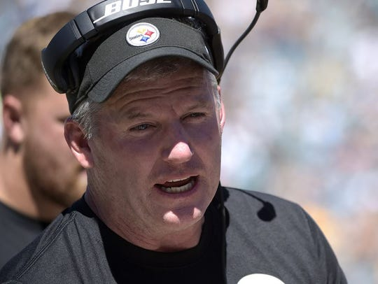 Pittsburgh Steelers offensive line coach Mike Munchak was a finalist for the head coaching job with the Denver Broncos job. That job went to Vic Fangio. AP FILE PHOTO