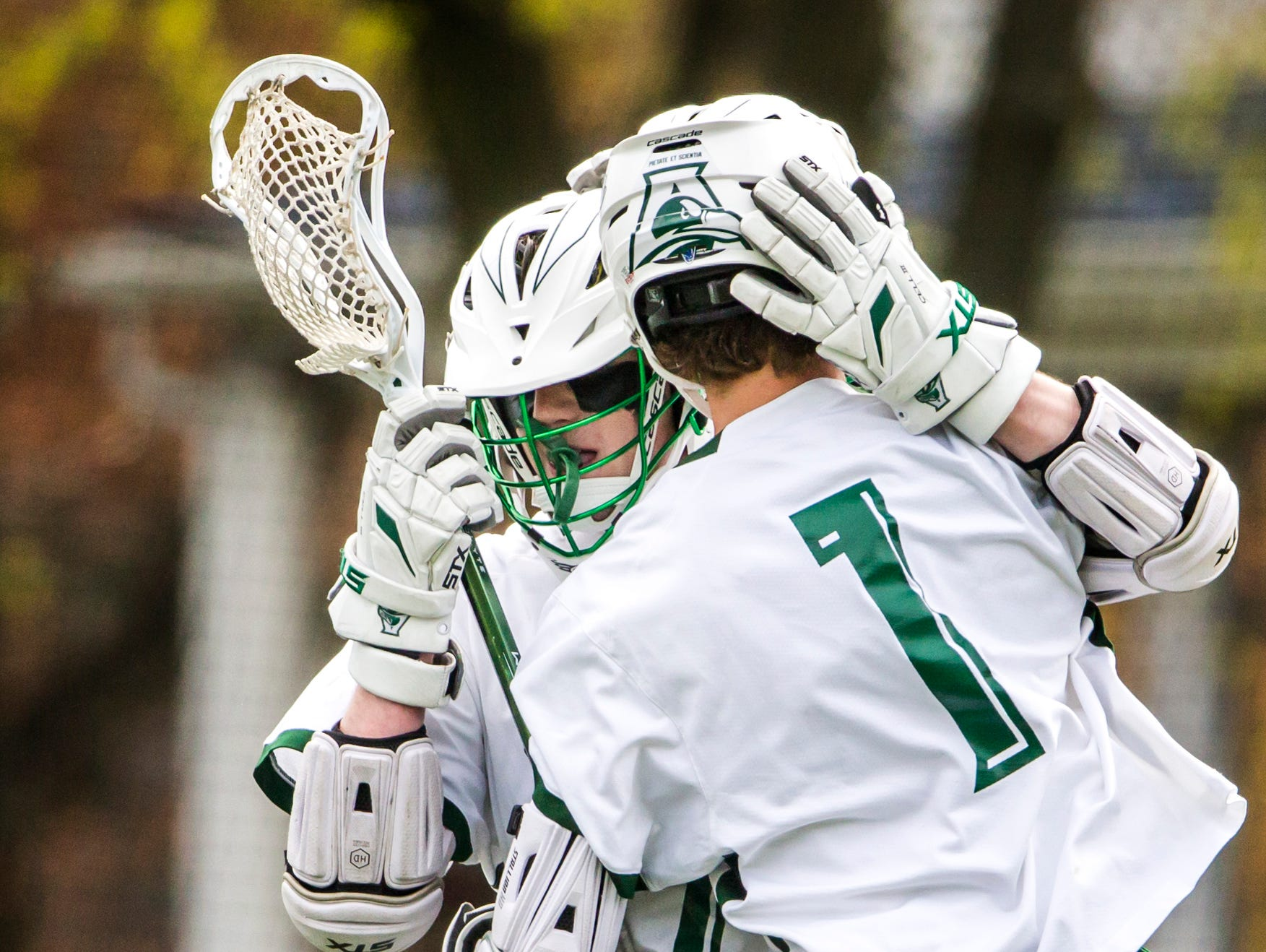 Archmere's Cole Bauer (right) hugs teammate Robert Baxter (left) after a goal in Archmere Academy's 13-8 win over Wilmington Friends School at Archmere on Thursday afternoon.