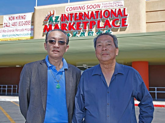 Jim Lai (L) and Peter Quach, co-owners of the AZ International