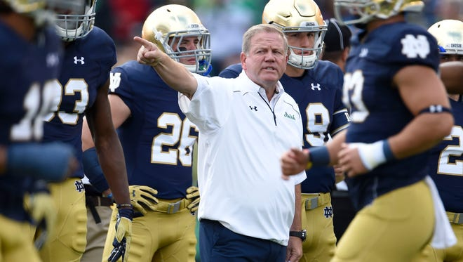 With the retirements of Virginia Tech's Frank Beamer and South Carolina's Steve Spurrier, Notre Dame's Brian Kelly (center) has the most wins of any active FBS coach.
