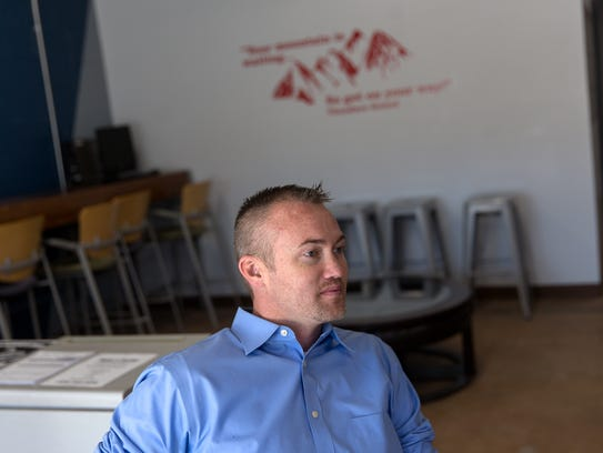 Aztec City manager Josh Ray talks during an interview,