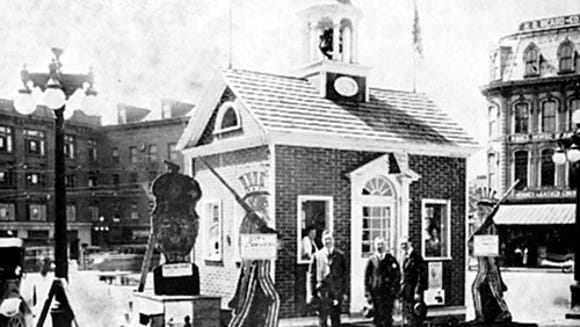 If the Elmwood Mansion is one of the largest structures moved in York County's past, the Little Courthouse is one of the smallest. It's seen here in its early years, serving as headquarters for World War I war bond sales on York's Continental Square. To the left of the courthouse,  an effigy of German emperor Wilhelm II stood. It was used for raising funds for the war - donations to the war effort were made in exchange for nails to drive into the emperor's wooden head.