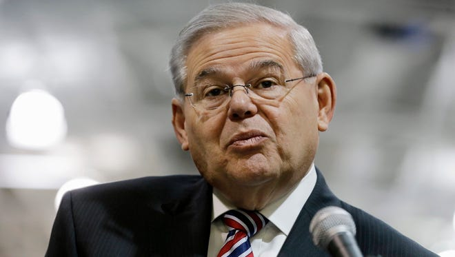 FILE - In this March 23, 2015 file photo, Sen. Robert Menendez, D-NJ, listens to a question while speaking in Garwood, N.J. Federal prosecutors are moving toward charging a Florida eye doctor over his dealings with Menendez, according to a person familiar with a Justice Department investigation into their relationship. The person said prosecutors are expected to bring charges against Dr. Salomon Melgen, whose medical offices were raided two years ago by federal authorities. Melgen has not been cooperating with prosecutors against Menendez, according to the person, who was not authorized to comment on the record about an ongoing federal investigation. (AP Photo/Mel Evans, File)