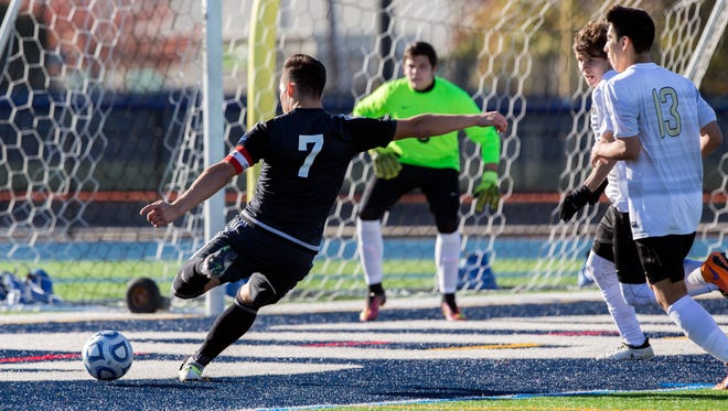 Gill St Bernard's Kevin Brito prepares to drive a shot past Hudson Catholic goalie Andres Gomes for his team's second goal of game during the Non-Public B final on Sunday at Kean University.
