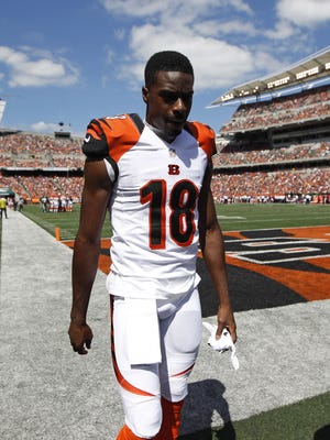 Cincinnati Bengals wide receiver A.J. Green (18) walks off the field and never comes back in the game with a toe injury during their game against the Atlanta Falcons at Paul Brown Stadium.