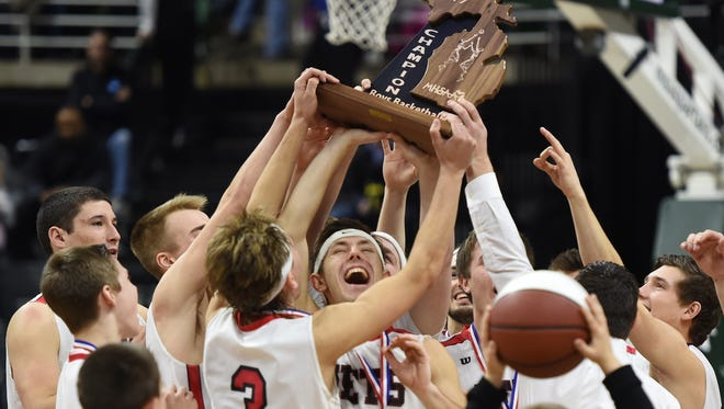 Powers North Central celebrates its state title over Buckley, 78-69, in the MHSAA Class D final at the Breslin Center on Saturday, March 25, 2017.