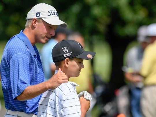 Peyton Blackard, 12 years-old, gets a few works of encouragement from his caddie Adam Bratton before Blackard starts a qualifying round of the Men's City Golf Tournament played at Evansville's Fendrich Golf Course Saturday, July 21, 2018.