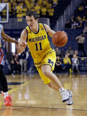 Andrew Dakich, who is no longer redshirting due to Spike Albrecht's injury, drives during the second half Saturday.