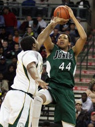 Roselle Catholic's Matt Bullock (left, in white) defends Karl-Anthony Towns during the 2013 Tournament of Champions final.