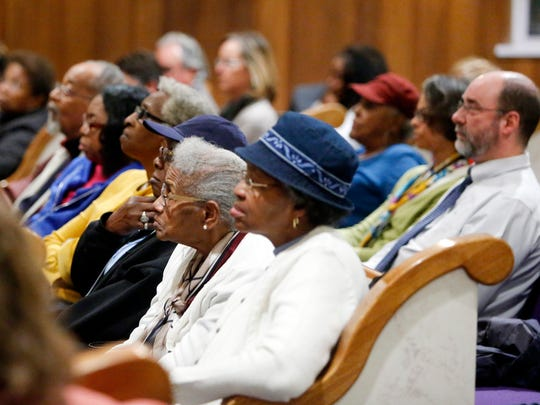 Audience members listen during a forum on race and justice in Delaware held at the Tabernacle Full Gospel Baptist Cathedral in Wilmington Tuesday.