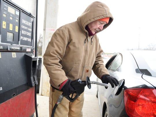 Matthew Heavey pumps fuel for customers at Talhelm's