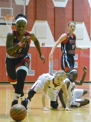 West Monroe's Jasmyn Johnson (15, left) goes after loose ball Friday ahead of Pineville's Sarah Karisny (center) and Hailee Wilkins (right).