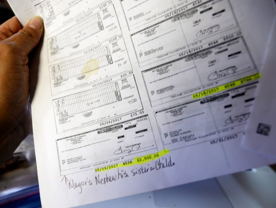 Paystubs show that Mayor Tommy Evans has been paying