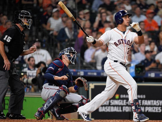 Houston Astros' Michael Brantley hits a two-run home run off Minnesota Twins starting pitcher Kohl Stewart during the third inning of a baseball game, Wednesday, April 24 in Houston.