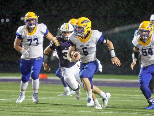 Newport Catholic running back Kyle Kelly [5] finds a big hole in the Camels defense.