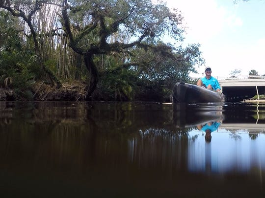 """The river itself is the lifeline of Estero,"" said Estero River Outfitters manager Justin Stuller, seen Tuesday on the river. Stuller, who grew up in Estero, spends much of his life on the water, kayaking, boating and fishing with his family. ""It's more than just a business for me. Being out on the water ... doing all the things we do on the water, it's a love for me. It's a love for my family."""