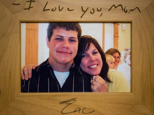 Brenda Easter is seen in a photo with her son Zac Easter. Zac was diagnosed with five concussions – three while playing football at Indianola High School – and developed CTE as a result. The disease tormented him in his final months of life and he committed suicide Dec. 19, 2015.