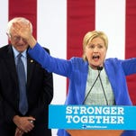 Sen. Bernie Sanders and  Hillary Clinton speak during a rally in Portsmouth, N.H., Tuesday, July 12, 2016.