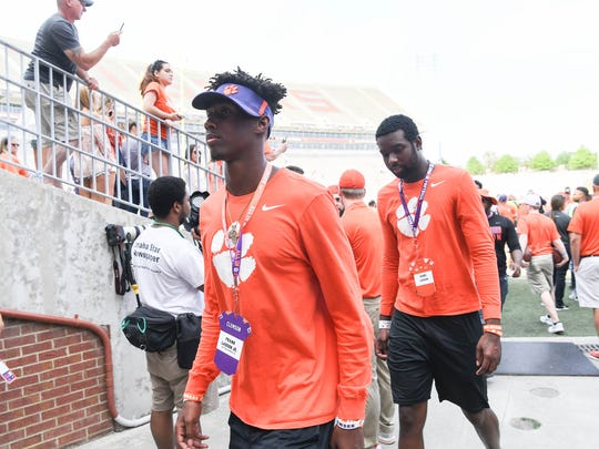 Frank Ladson, Jr.. left, walks around after the spring game in Memorial Stadium in Clemson on Saturday, April 14, 2018.
