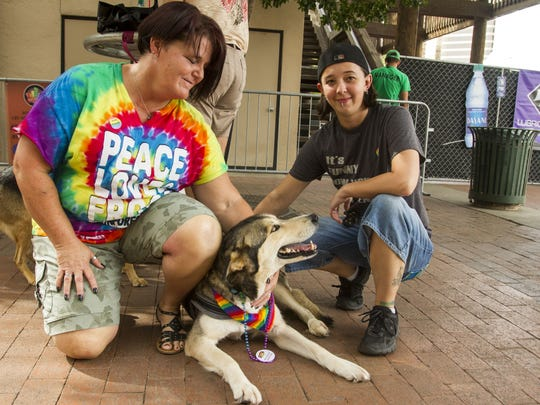 Tammy Allan, Brittany Allan and their dog Bella enjoy the Rainbows Festival, presented by Phoenix Pride, on downtown Phoenix on Oct. 18, 2015.