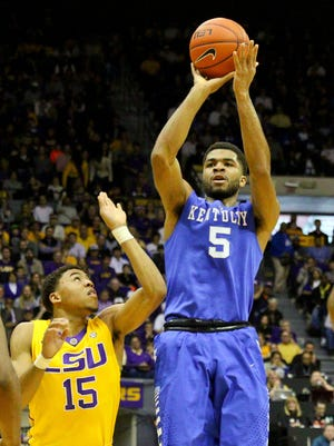 Feb 10, 2015; Baton Rouge, LA, USA; Kentucky Wildcats guard Andrew Harrison (5) shoots over LSU Tigers guard Jalyn Patterson (15) during the first half of a game at the Pete Maravich Assembly Center. Mandatory Credit: Derick E. Hingle-USA TODAY Sports