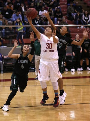 Shiprock's Tia Woods shoots a layup against Farmington on Saturday at the Chieftain Pit in Shiprock.