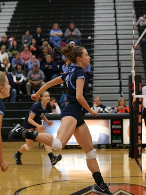 Adena's Carissa Poehler spikes a ball at the net against Zane Trace on Oct. 31 in a Division III district volleyball final at Waverly High School.
