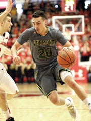 Vermont's Ernie Duncan is defended by Stony Brook's