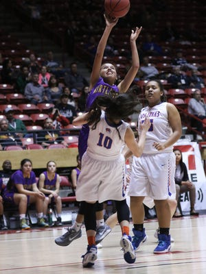 Kirtland Central's Haile Gleason shoots over Los Lunas' Mica Jenrette on Tuesday during their 5A quarterfinal game in Albuquerque.