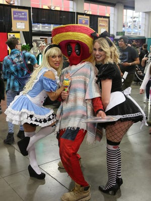 Cosplayers pose for a photo during FanX17.