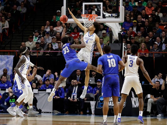 Kentucky forward Nick Richards (4) blocks a shot by Buffalo forward Nick Perkins (33) during the first half of a second-round game in the NCAA men's college basketball tournament Saturday, March 17, 2018, in Boise, Idaho. (AP Photo/Otto Kitsinger)