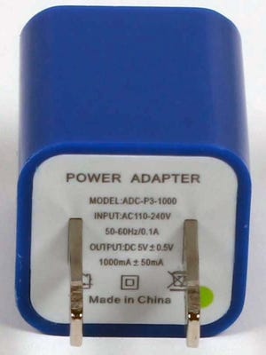 This undated photo provided by the U.S. Consumer Product Safety Commission shows a Gemini power adapter. The adapters are being recalled because they can overheat, posing a burn hazard.