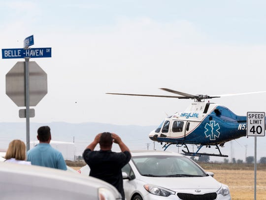A medical helicopter departs the scene Tuesday, May