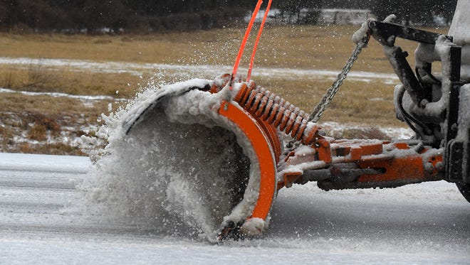 A Mountain Home Street Department plow moves snow early Wednesday afternoon. Around $60,000 has been spent on labor, equipment and materials during the 2014-2015 winter season clearing city streets.