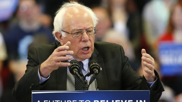 Bernie Sanders speaks during a town hall on the campus
